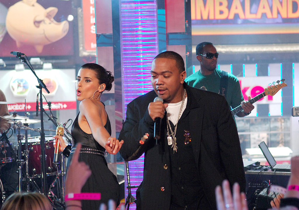 Nelly Furtado and Timbaland perform on stage together.