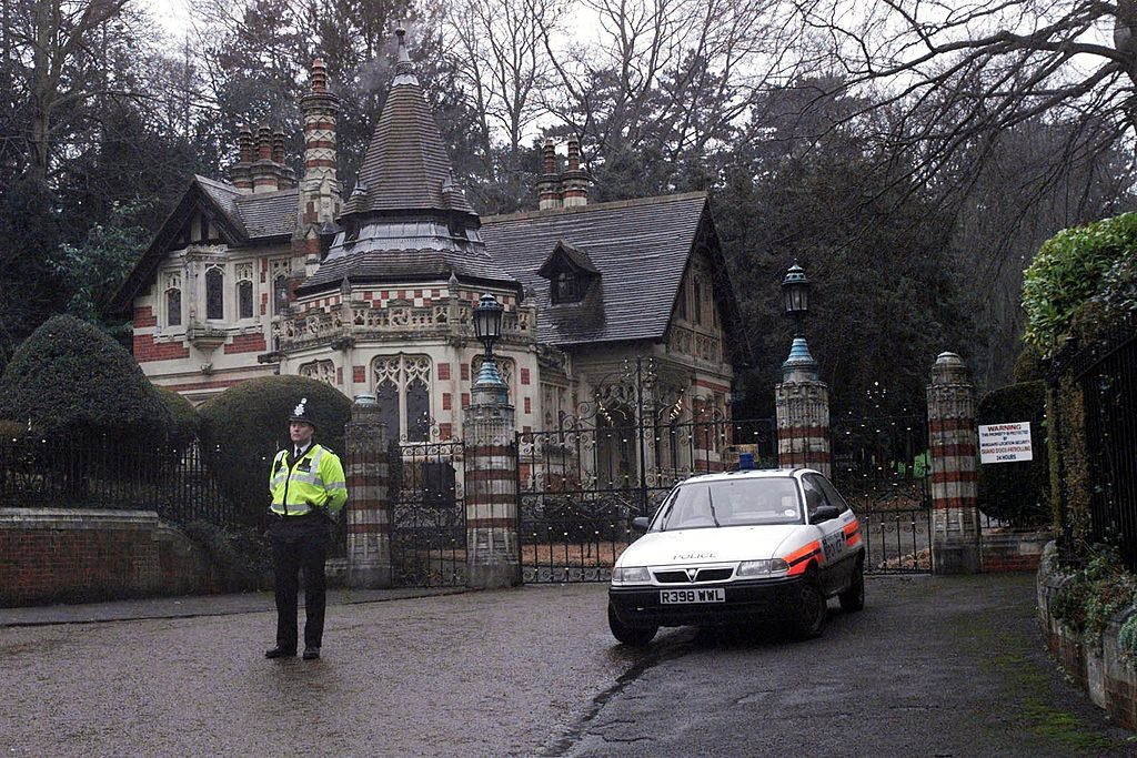 The scene outside George and Olivia Harrison's Friar Park home after they were attacked by an intruder.