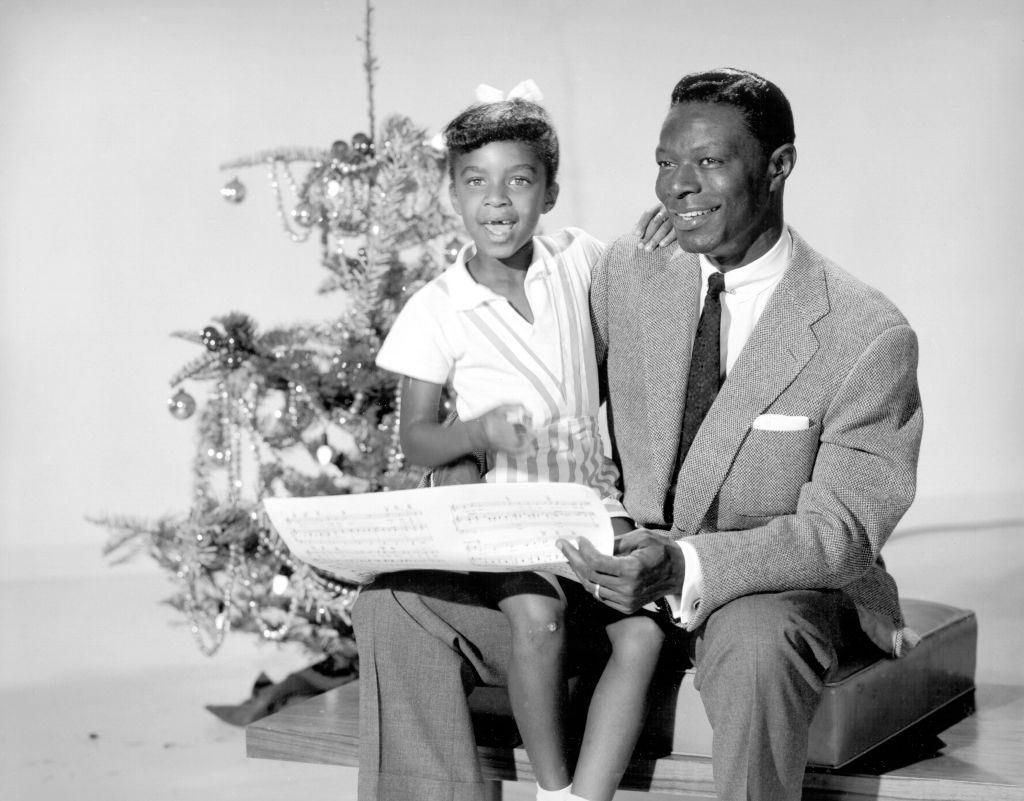 Nat King Cole and his daughter, Natalie Cole, at Christmastime, 1955