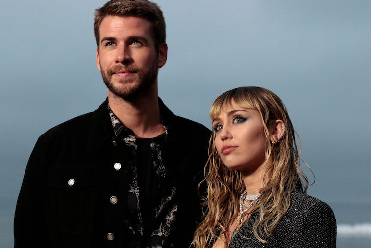 Liam Hemsworth and Miley Cyrus pose for a photo