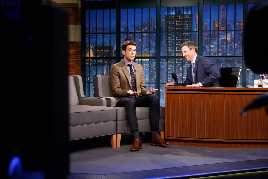 Comedian John Mulaney talks with host Seth Meyers