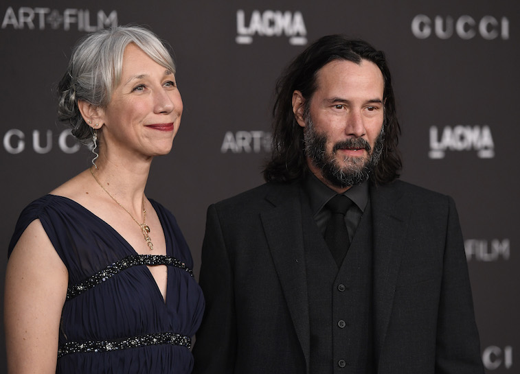 Keanu Reeves and Alexandra Grant on the red carpet