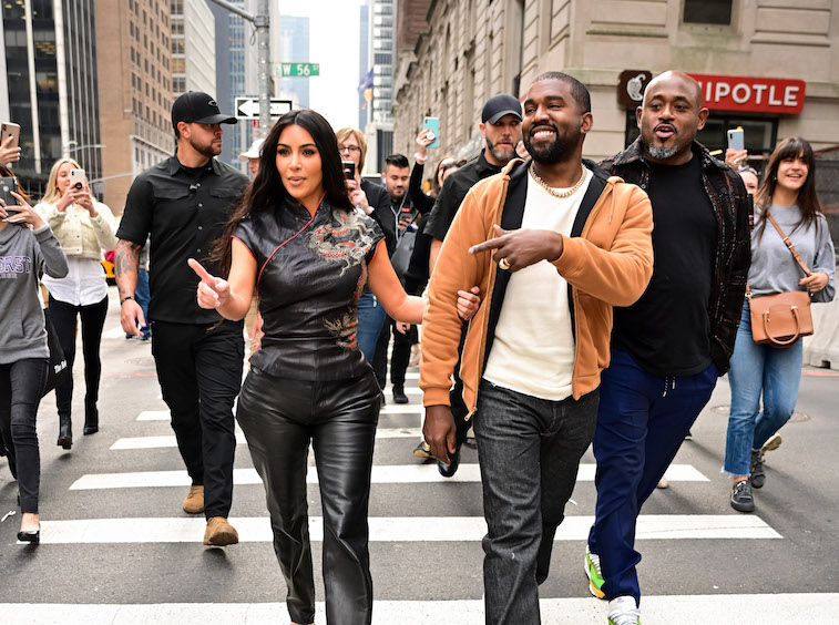Kanye West and Kim Kardashian walking down the street in New York