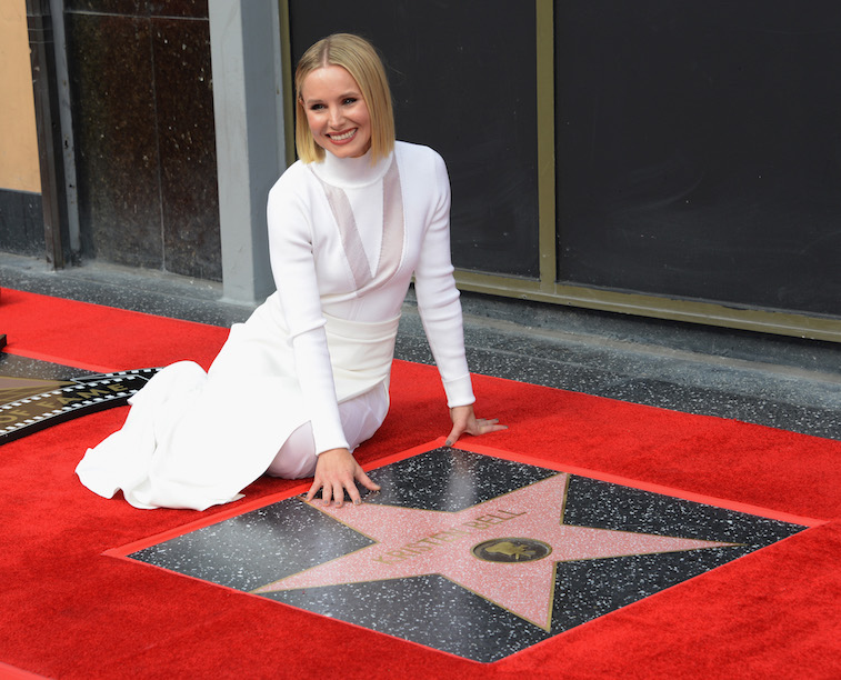 Kristen Bell next to her Hollywood star