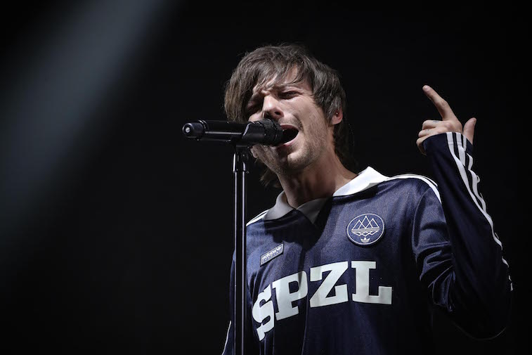 Louis Tomlinson performs onstage