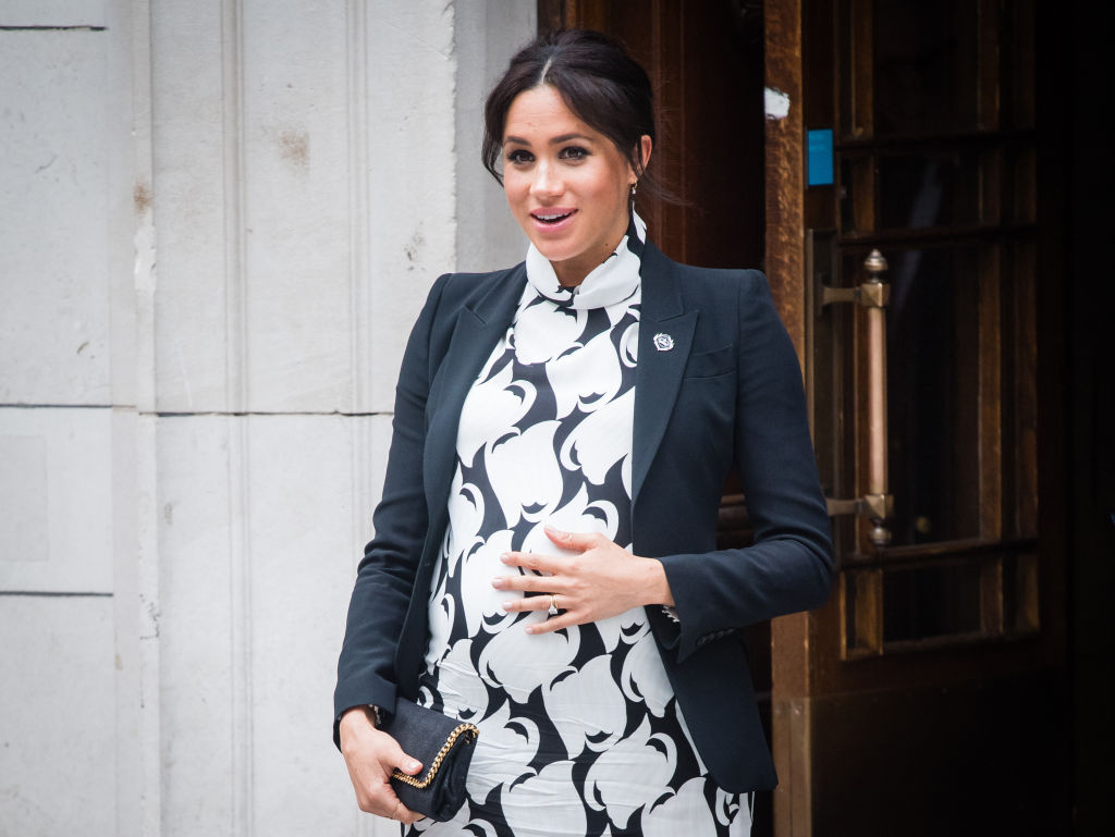 Meghan Markle smiles for the camera