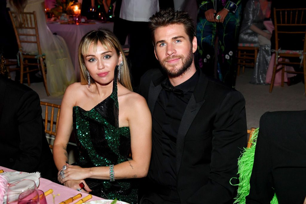 Miley Cyrus and Liam Hemsworth attend The 2019 Met Gala Celebrating Camp