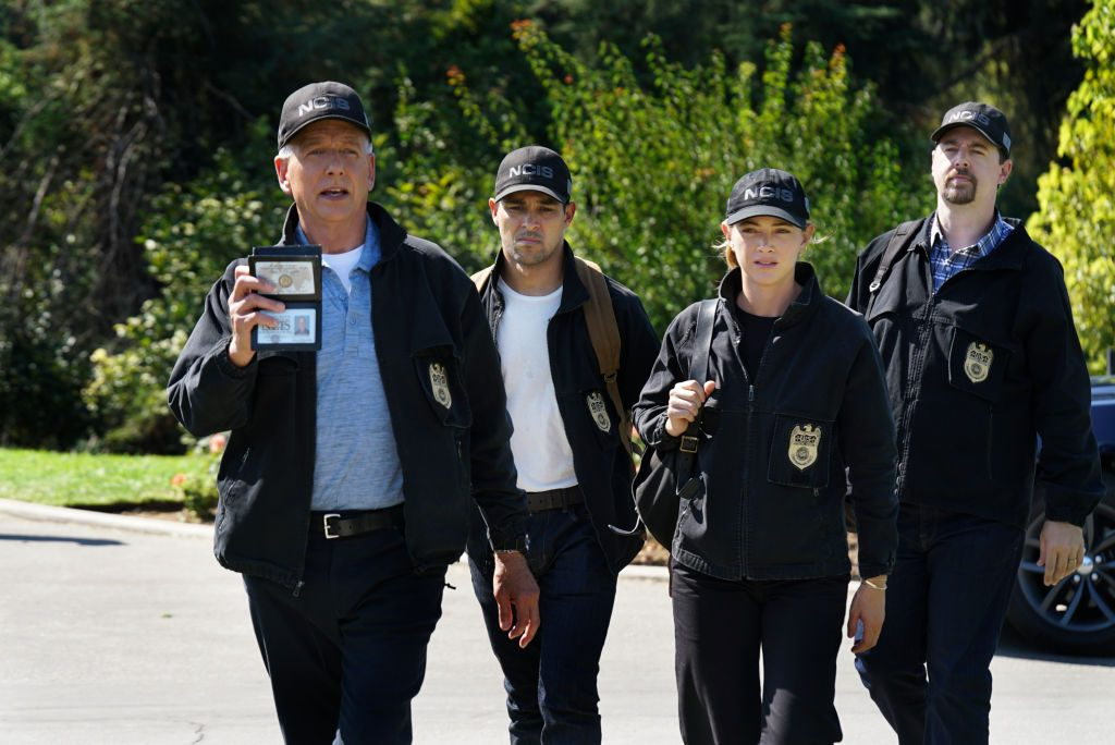 """Mark Harmon as NCIS Special Agent Leroy Jethro Gibbs, Wilmer Valderrama as NCIS Special Agent Nicholas """"Nick"""" Torres, Emily Wickersham as NCIS Special Agent Eleanor """"Ellie"""" Bishop, and Sean Murray as NCIS Special Agent Timothy McGee."""