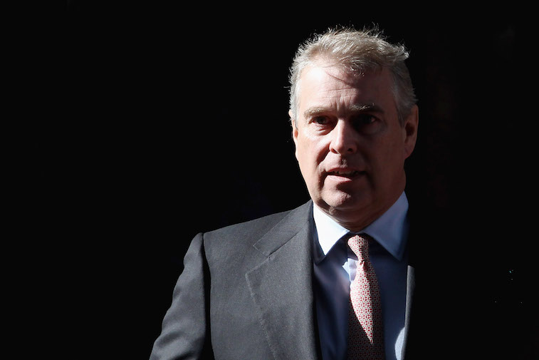Prince Andrew leaving a building