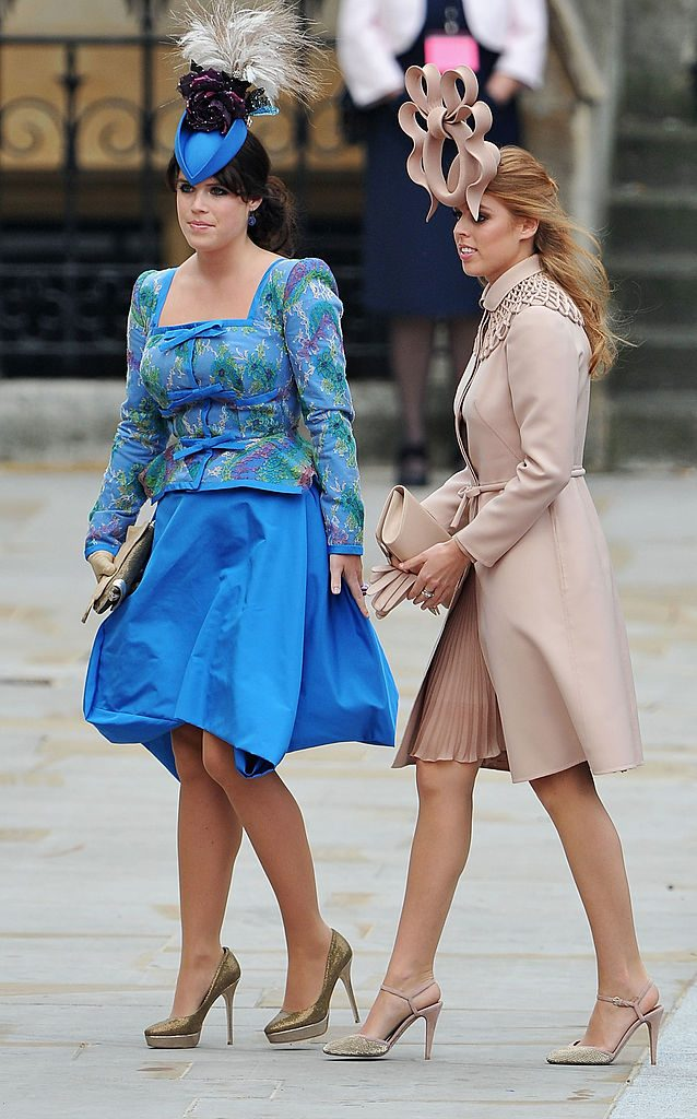 Princess Eugenie of York (L) and Princess Beatrice of York arrive to attend the Royal Wedding of Prince William to Catherine Middleton at Westminster Abbey on April 29, 2011