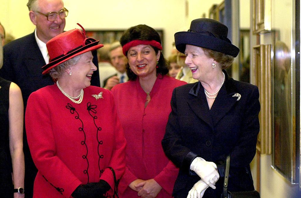 Britain's Queen Elizabeth II (left) chats with former Conservative Prime Minister Baroness Thatcher while opening a new wing of the National Portrait Gallery in London 04 May 2000