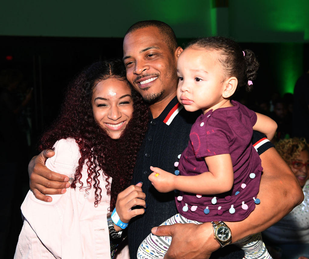 T.I. poses with his daughters Deyjah Harris and Heiress Diana Harris.