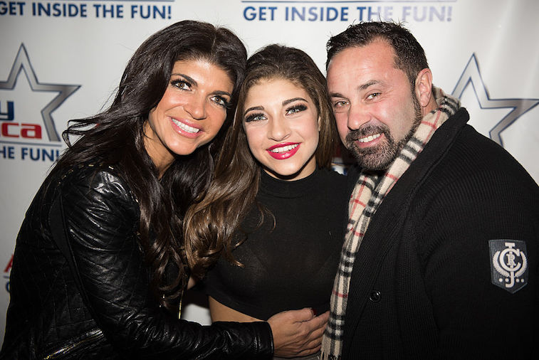 Gia Giudice stands in between her mother and father, Teresa and Joe Giudice