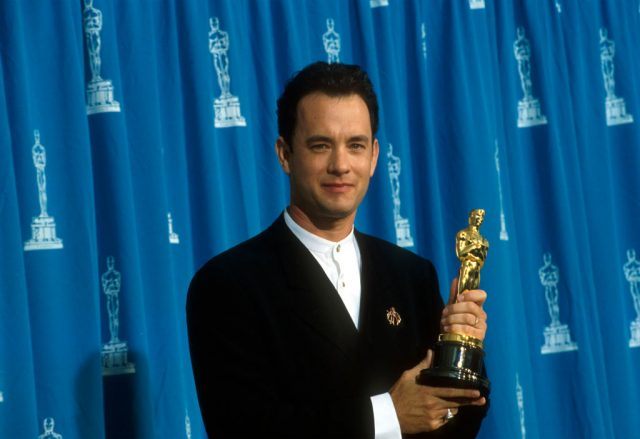 Tom Hanks receives his Oscar at the Academy Awards in 1995