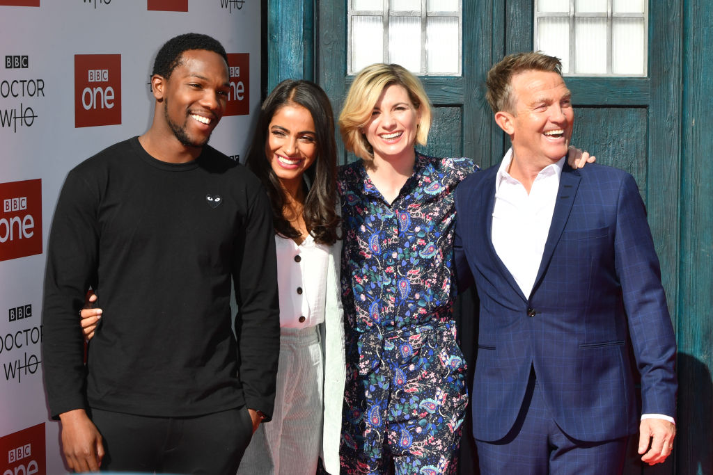 Doctor Who cast (Tosin Cole, Mandip Gill, Jodie Whittaker, and Bradley Walsh). The cast except for Walsh surprised a fan at BBC's Children in Need show.