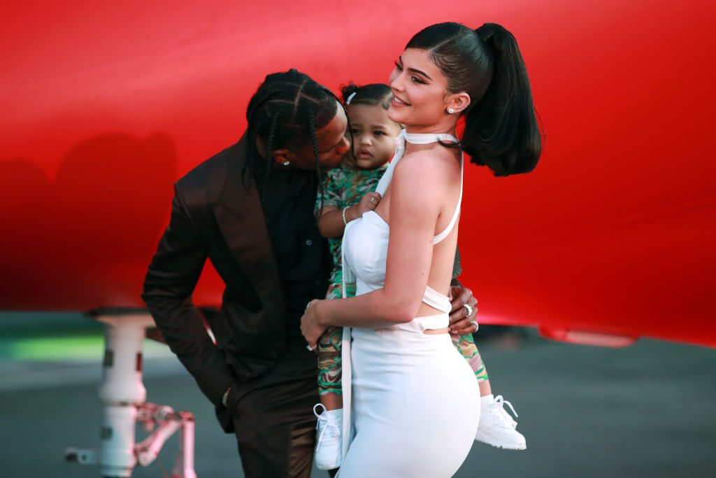 Travis Scott, Stormi Webster, and Kylie Jenner on the red carpet