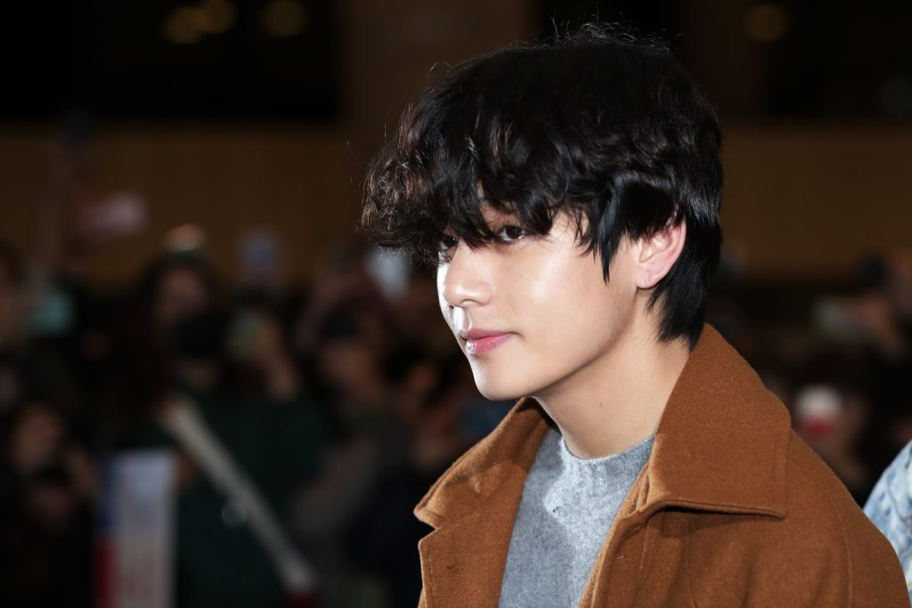 V of boy band BTS is seen on departure at Gimpo International Airport on November 21, 2019