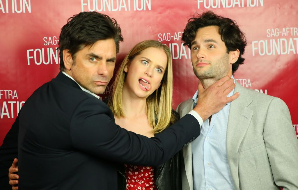 Elizabeth Lail Penn Badgley and John Stamos