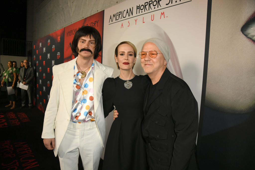 Evan Peters, Sarah Paulson, and Ryan Murphy pose on the red carpet for the 100 episode celebration of 'American Horror Story.'