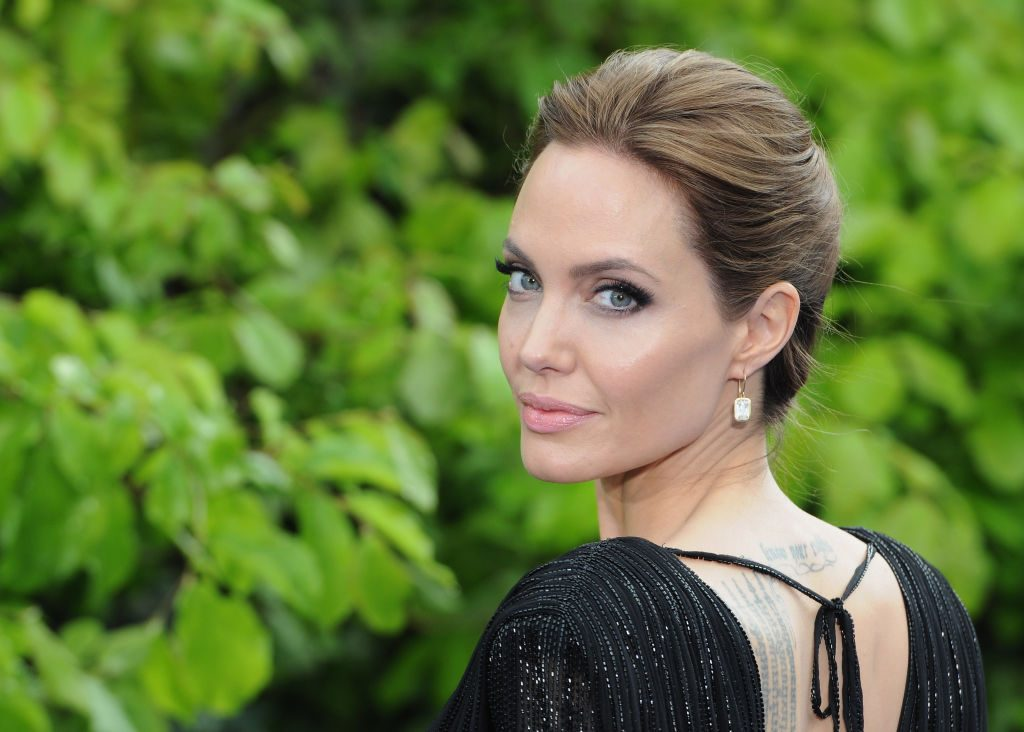 "Angelina Jolie attends a private reception as costumes and props from Disney's ""Maleficent"" are exhibited."