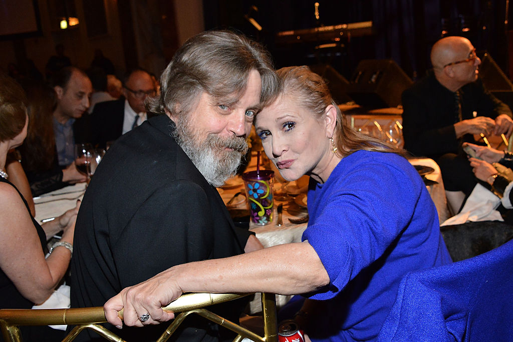 Mark Hamill and Carrie Fisher pose at the Golden Heart Gala in 2014.