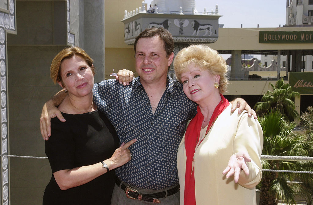 Carrie Fisher and brother Todd Fisher pose with their mother Debbie Reynolds.