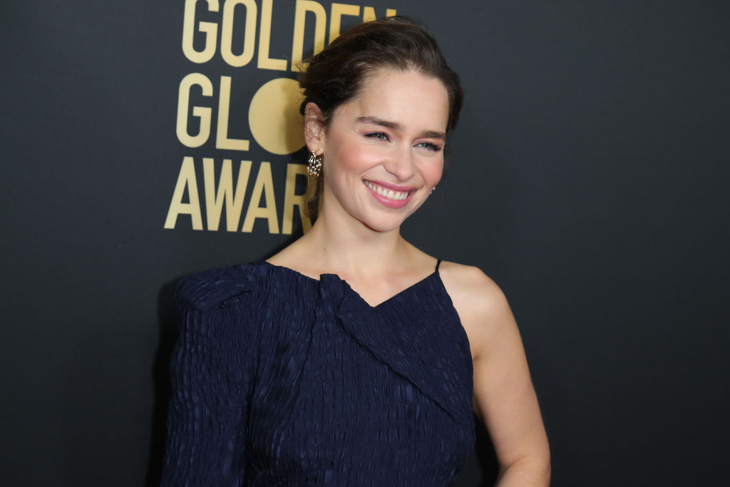 Emilia Clarke poses at the HFPA And THR Golden Globe Ambassador Party.