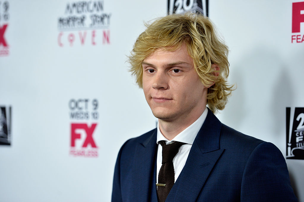 Evan Peters poses at the premiere of FX's 'American Horror Story: Coven,' the season where he played Kyle Spencer.