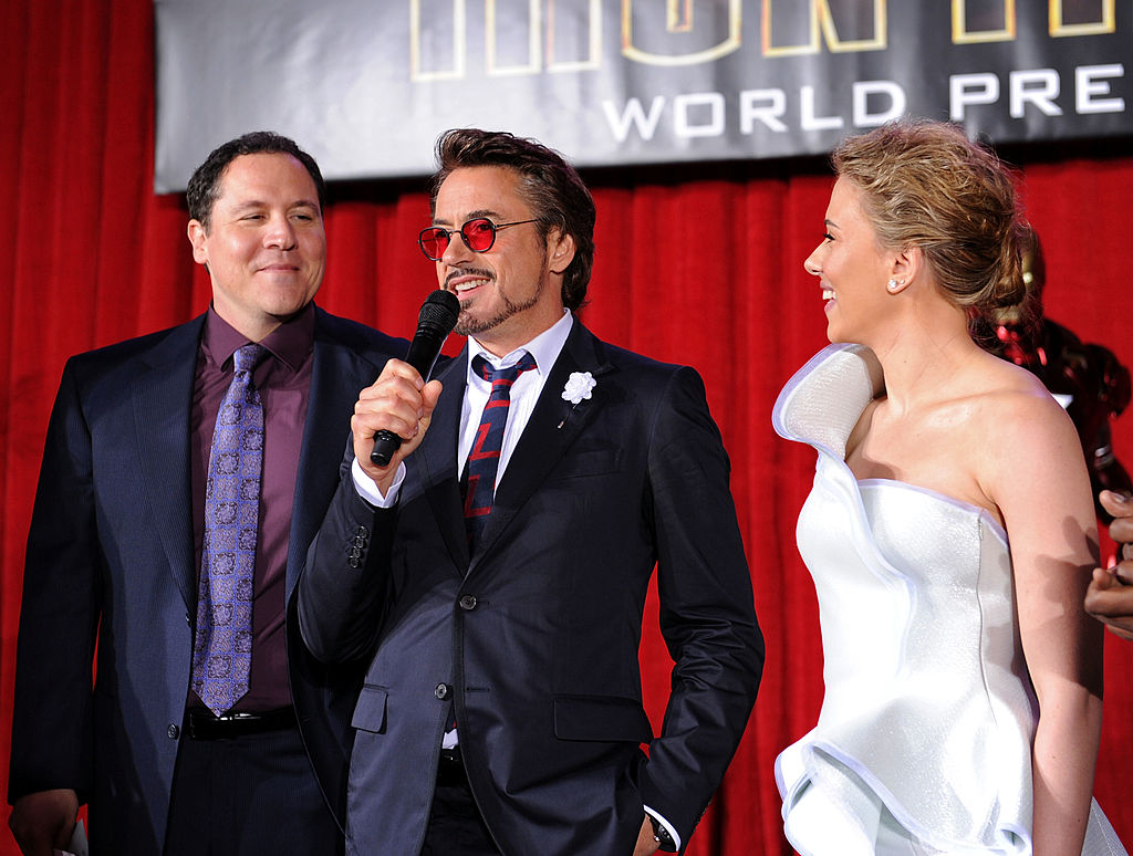 Jon Favreau, Robert Downey Jr., and Scarlett Johansson speak at the 'Iron Man 2' premiere.