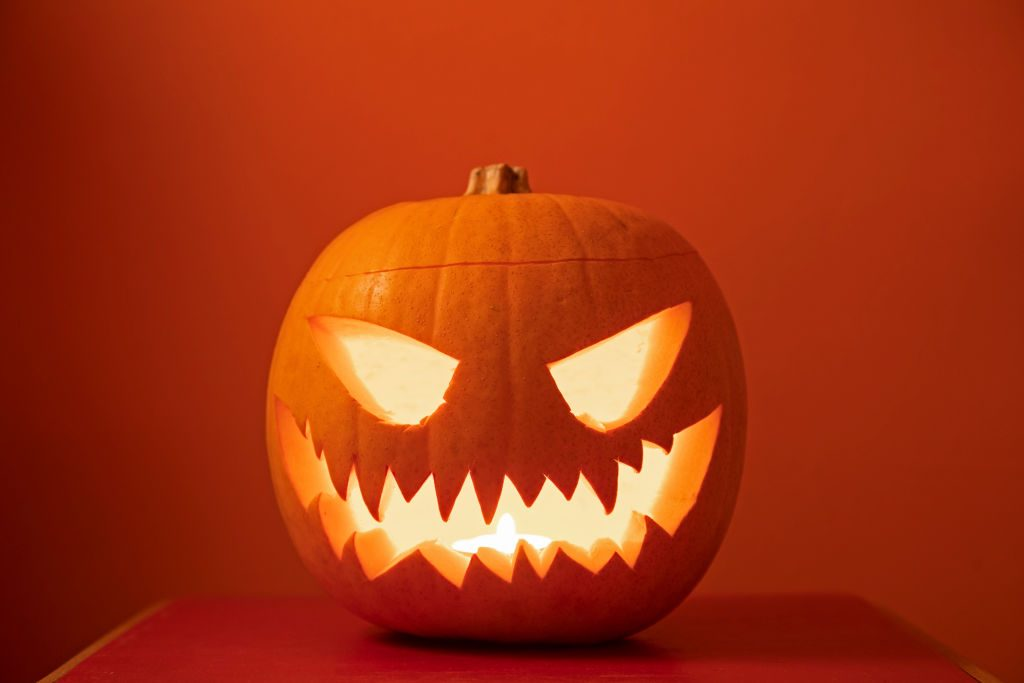 Jack o lantern on orange background
