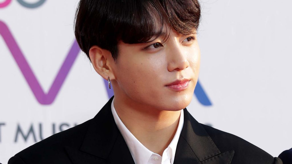 JungKook of boy band BTS attends the photocall for U Plus 5G 'The Fact Music Awards' on April 24, 2019