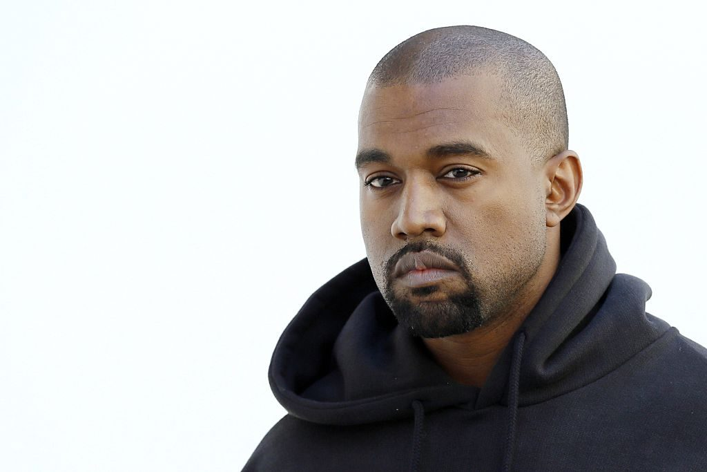 Kanye West poses before Christian Dior 2015-2016 fall/winter ready-to-wear collection fashion show.