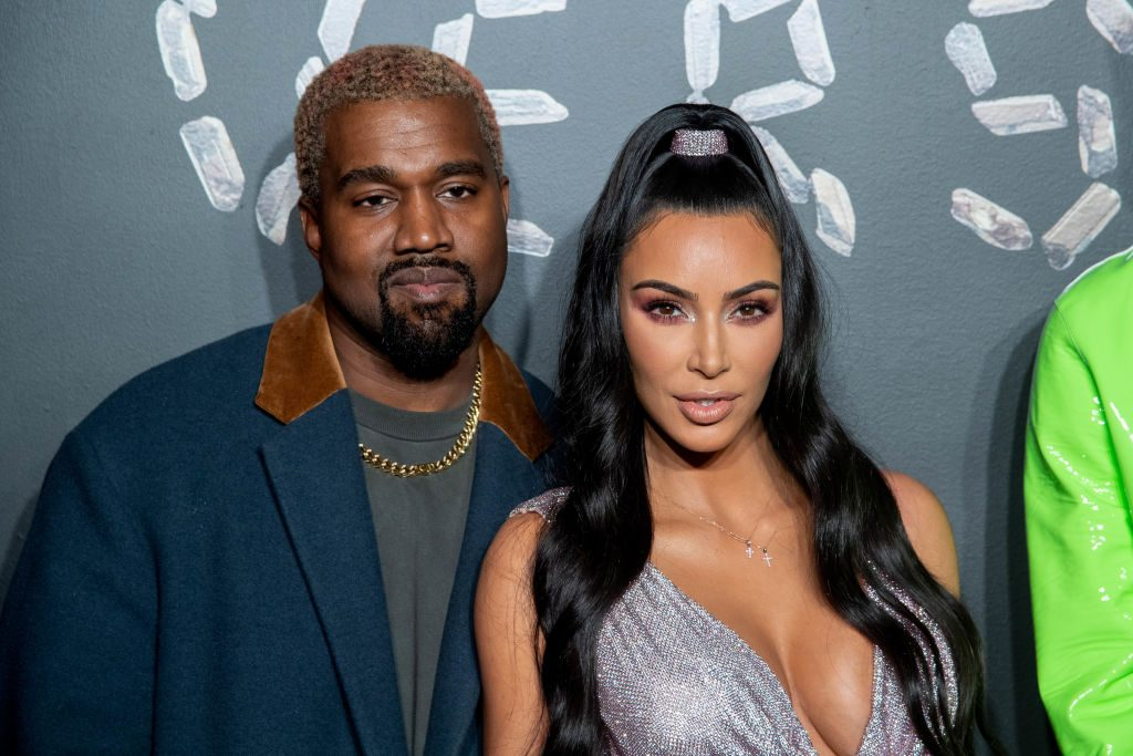 Kanye West and Kim Kardashian West attend the Versace fall 2019 fashion show.