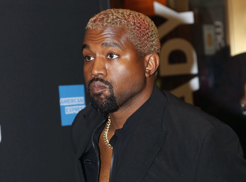 """Kanye West poses at the opening night of the new musical """"The Cher Show"""" on Broadway."""