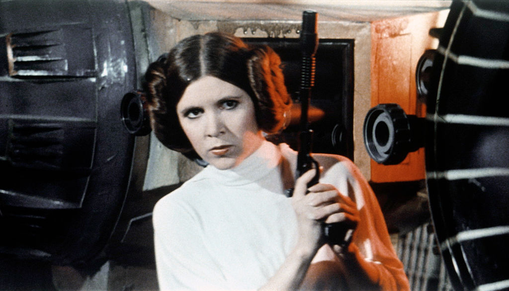 Princess Leia (Carrie Fisher) holds a gun in 'Star Wars: Episode IV — A New Hope.'