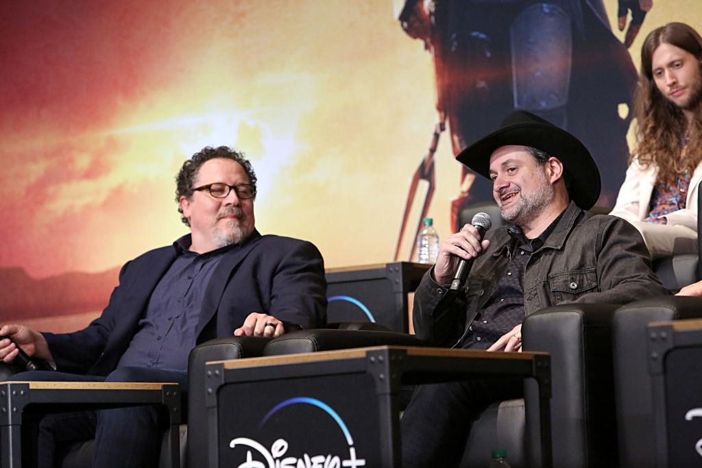 Executive Producer Jon Favreau and Executive Producer/Director Dave Filoni speak on a panel at 'The Mandalorian' premiere.