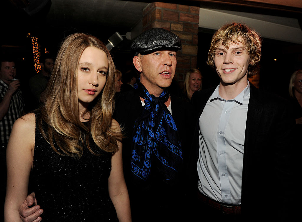 """Taissa Farmiga (Violet), creator Ryan Murphy, and Evan Peters (Tate) pose at the after-party for FX's """"American Horror Story: Murder House' premiere."""