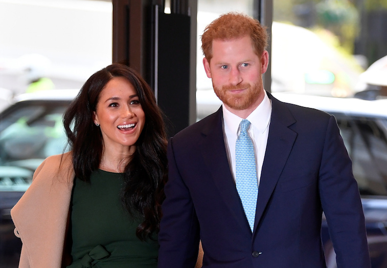 Prince Harry and Meghan Markle smiling at the camera