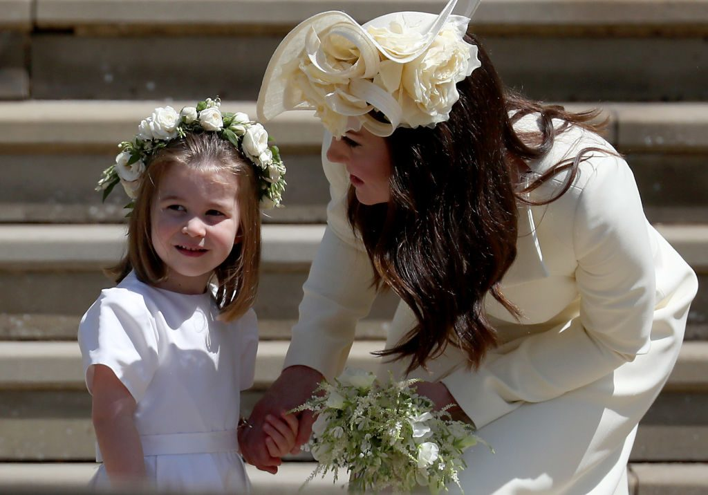 Princess Charlotte of Cambridge stands on the steps with her mother Catherine, Duchess of Cambridge.