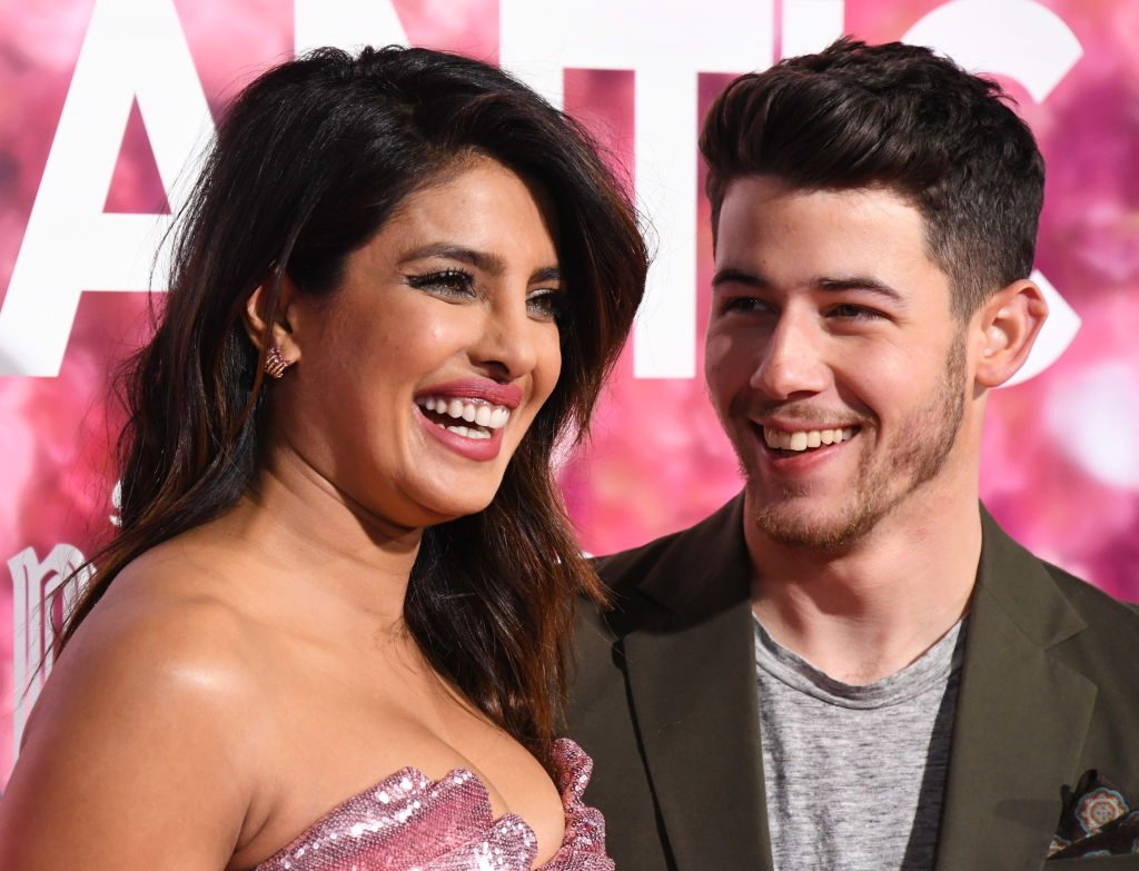 "Priyanka Chopra and Nick Jonas attend the premiere of Warner Bros. Pictures' ""Isn't It Romantic"" at The Theatre at Ace Hotel."