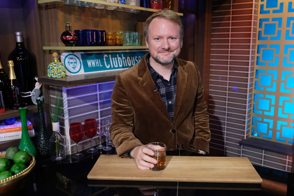 Rian Johnson poses with a drink on the set of 'Watch What Happens Live.'