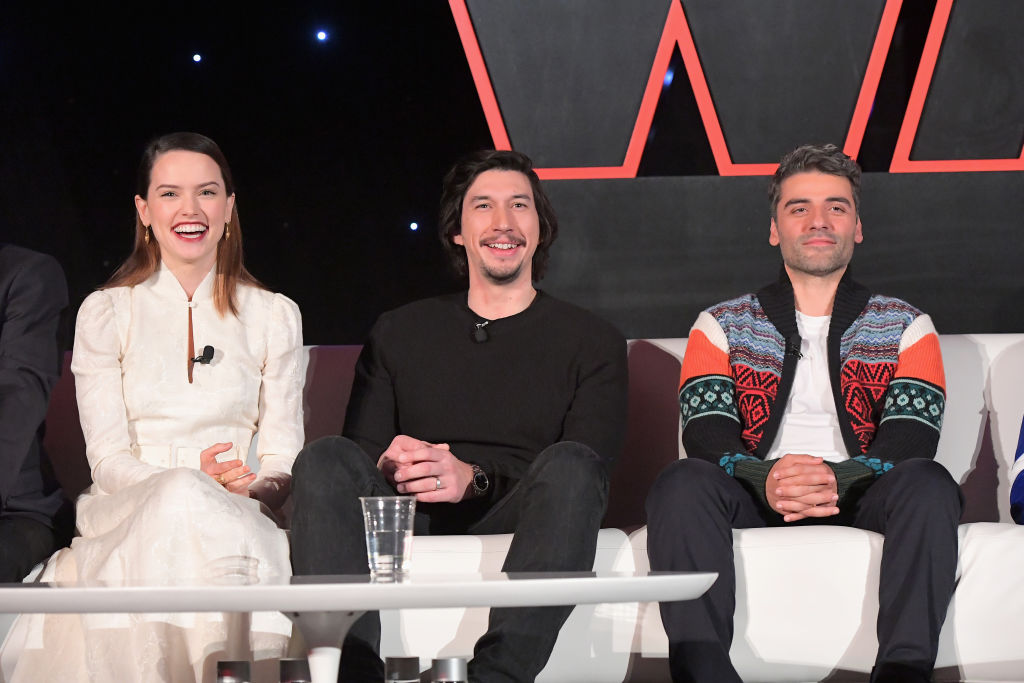 Daisy Ridley, Adam Driver, and Oscar Isaac smile during a press conference for 'The Last Jedi.'