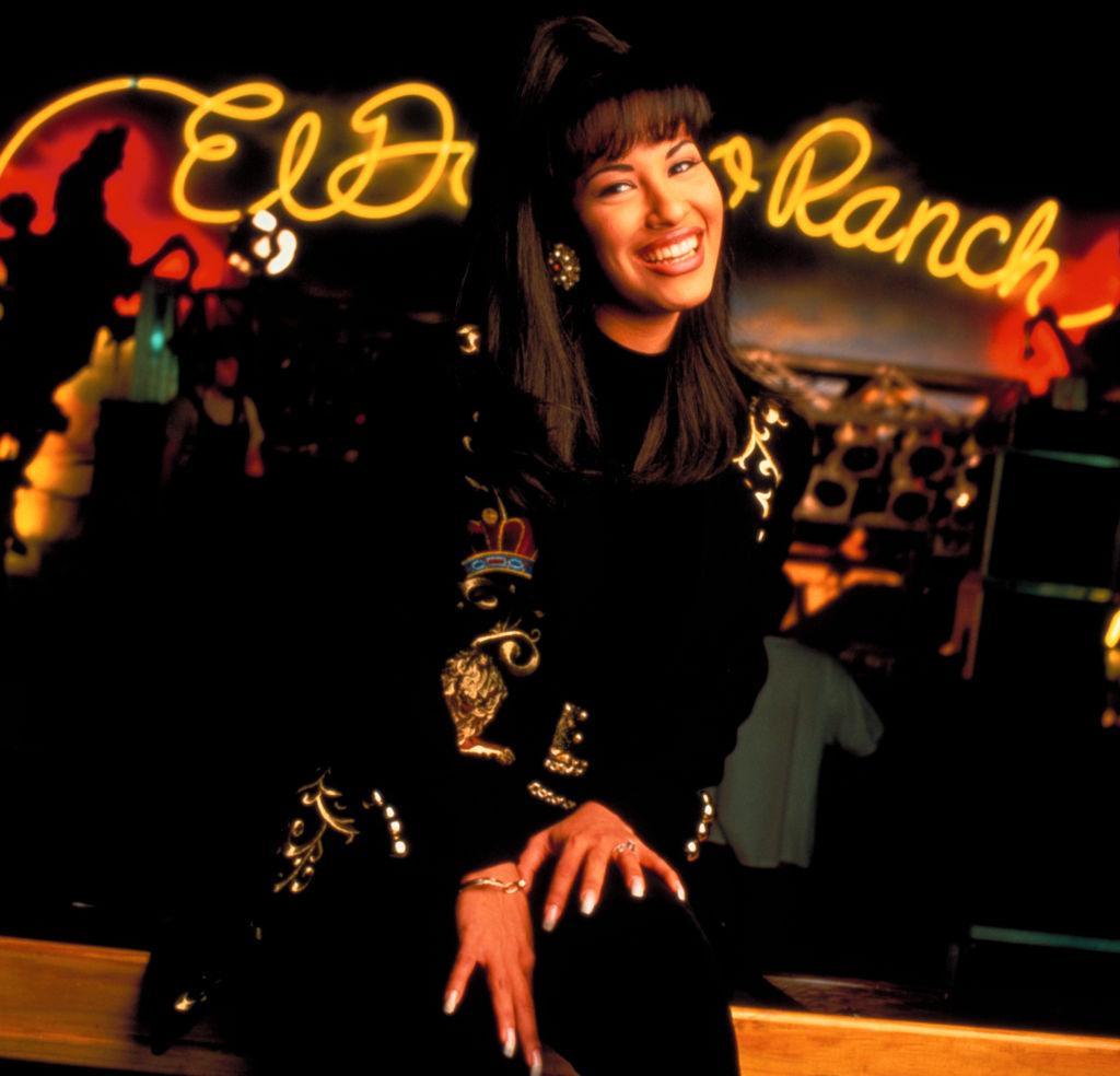Selena Quintanilla poses inside a nightclub.