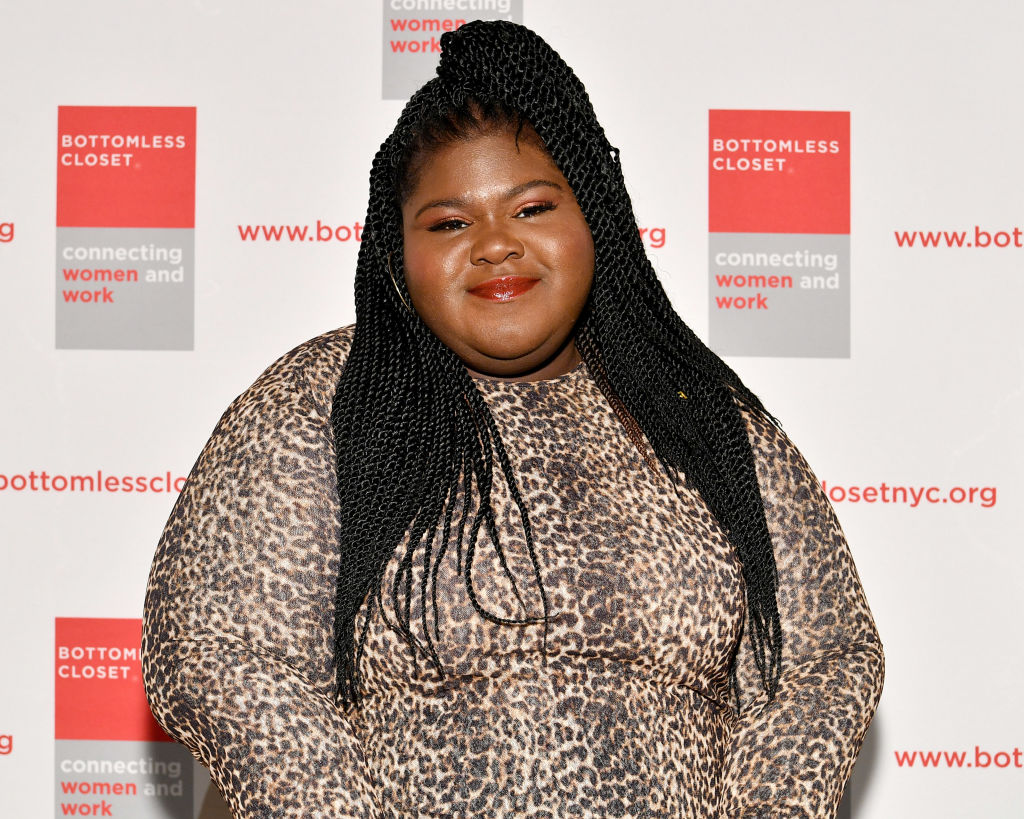 Gabourey Sidibe poses on the red carpet for the 20th Anniversary Bottomless Closet Luncheon