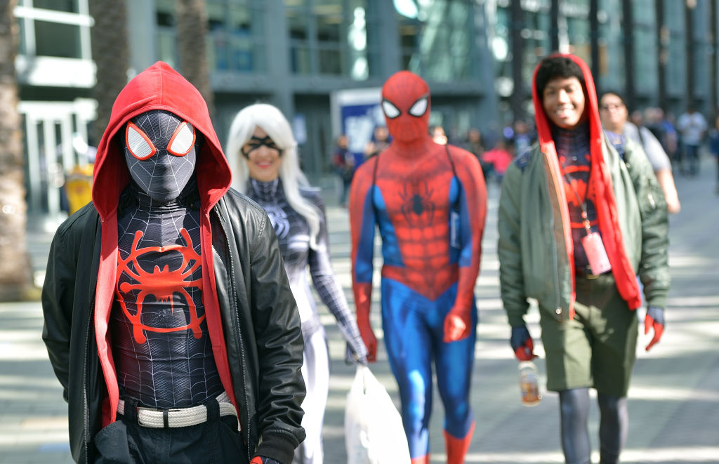 A group of cosplayers dressed as Miles Morales and Spider-Man take to the streets at a convention.