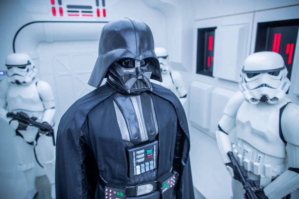 Replicas of Darth Vader and Stormtroopers on a space craft.