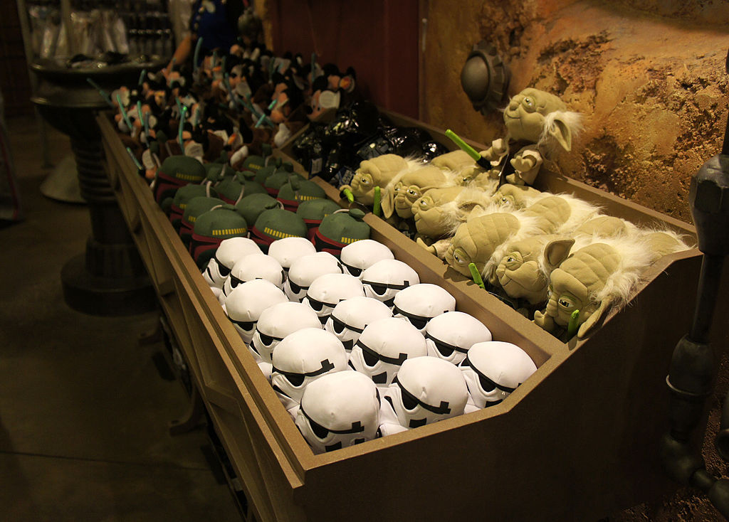 Star Wars toys in bins at Disney World. Including Stormtroopers, Yoda, and Boba Fett.