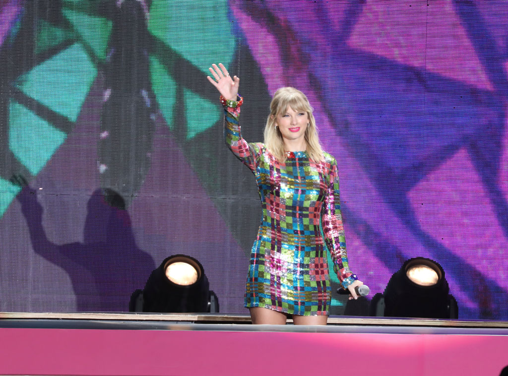 Taylor Swift waving to fans at Tianhe Sports Center in Guangzhou, Guangdong Province of China.