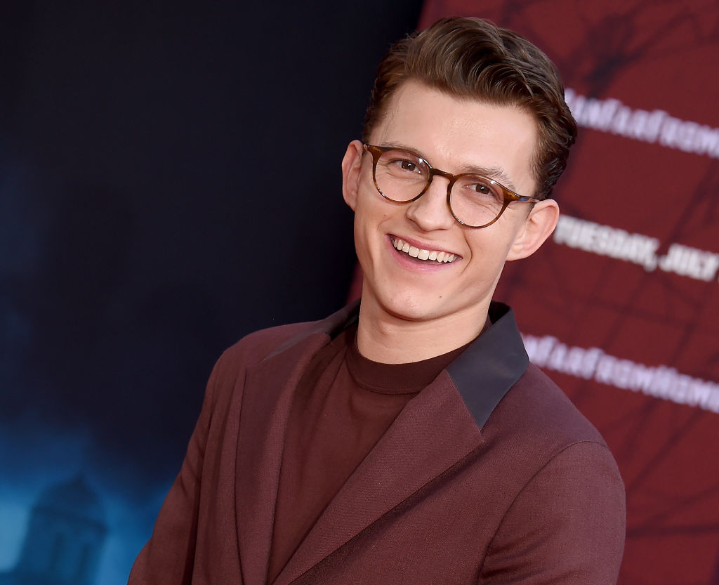 Tom Holland posing on the red carpet for 'Spider-Man: Far From Home.'