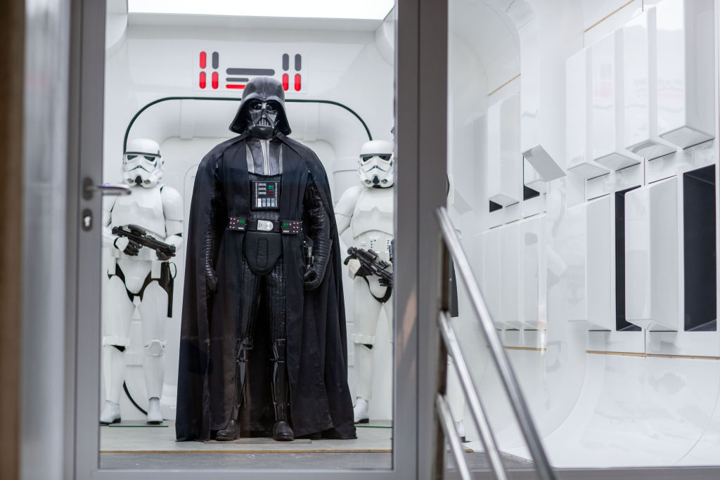 Darth Vader standing with two Stormtroopers.
